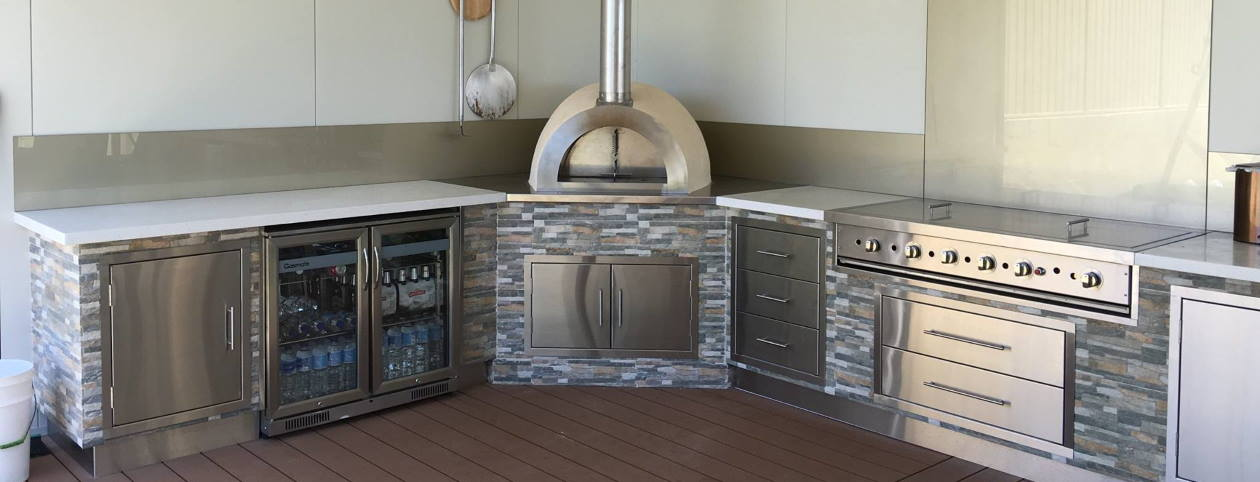 Wildfire model wood fired oven set into a stunning kitchen