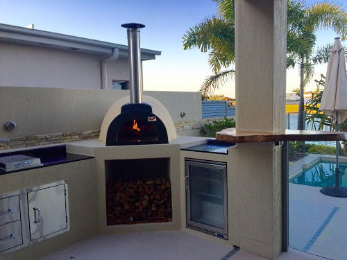 An Alfresco wood fired oven in an outdoor setting