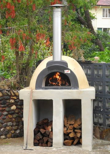 an alfresco wood fired oven on a concrete base