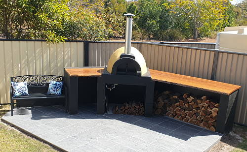 an outdoor pizza oven on an L shaped stand